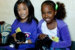 Kids at SPCA with kitten